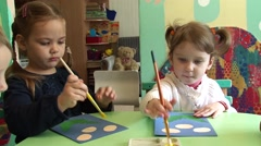 Two cute little girls drawing for the first time, Close-up Stock Footage