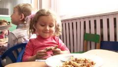 Adorable little girl having breakfast in a kindergarten, Close-up Stock Footage