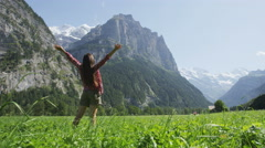 Happy free woman with arms outstretched in freedom nature excited of joy - stock footage