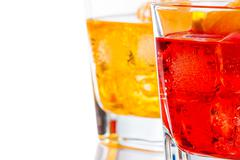 red and yellow cocktail with orange slice isolated on white background - stock photo