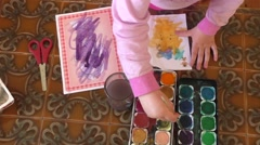 Little child coloring in coloring book Stock Footage