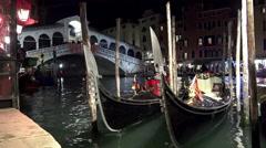Stock Video Footage of 4K night view of gondola near Rialto bridge