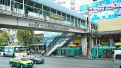 BANGKOK, THAILAND - CIRCA FEB 2015: Photographer Shooting City Traffic from a Stock Footage