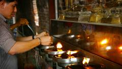 AYUTTHAYA, THAILAND - CIRCA FEB 2015: Buddhist Worshippers Lighting Incense f Stock Footage