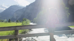 Switzerland nature Swiss Alps landscape with river - Woman hiker resting Stock Footage