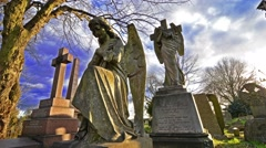 Angel statue in a cemetery with time lapse clouds - stock footage