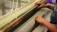 BANG PA-IN, THAILAND - CIRCA NOV 2013: Local artisan weaving beautiful patter Stock Footage