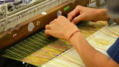 BANG PA-IN, THAILAND - CIRCA NOV 2013: Local artisan weaving a beautiful, col Stock Footage