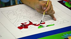 BANG PA-IN, THAILAND - CIRCA NOV 2013: Local artist painting a red and green, Stock Footage