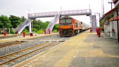 BANG PA-IN, THAILAND - CIRCA NOV 2013: Crowded passenger train cruises throug Stock Footage