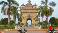 VIENTIANE, LAOS - CIRCA DEC 2013: Patuxai Arch, a war memorial, stands majest Stock Footage