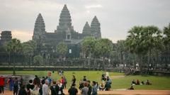 ANGKOR, CAMBODIA - CIRCA DEC 2013: Tourists visitng Angkor Wat temple, a worl Stock Footage