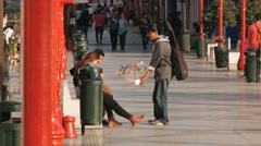 Man sells sweets at the street of Arica, Chile. Stock Footage
