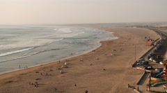 View to the sandy beach with people in Arica, Chile. Stock Footage