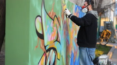 Street art people and urban wall graffiti Ghetto art  - stock footage