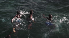 Swimming boys in Slow Motion Africa Stock Footage