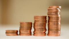 Rising columns of coins. - stock footage