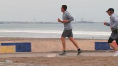 People from the Chilean army jogging by the sea side in Arica, Chile. Stock Footage