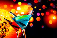Blue and red cocktail with sparkling disco ball background with space for tex Stock Photos