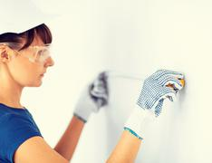 architect measuring wall with flexible ruller - stock photo