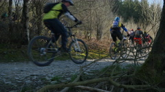 Massive group of mountain bikers begin a climb from trail centre Stock Footage