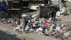 Men picking through garbage on the street of Mumbai. Stock Footage