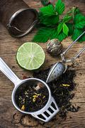 Tea brew with lime and mint on wooden background Stock Photos