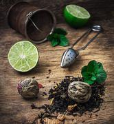 Tea brew with lime and mint on wooden background Kuvituskuvat