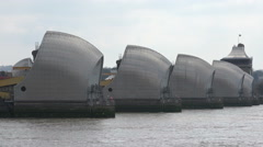 Yacht passes Thames Barrier on River Thames, London, England Stock Footage