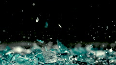 Shattering glass and splashing water in slow motion - stock footage