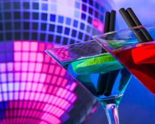 Blue cocktail with sparkling disco ball background with space for text, dance Stock Photos