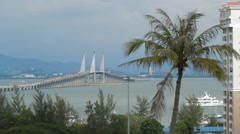 Wide Angle Shot of Penang Bridge With Coconut Tree in Foreground Stock Footage