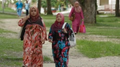 Two Malay Students Walking and Talking on USM Campus in Malaysia Stock Footage