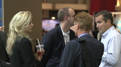 People mingling at a trade show event Stock Footage