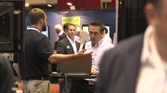 People networking at a tradeshow - stock footage