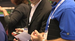 People talking at a trade show event Stock Footage