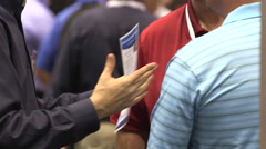 People networking at a tradeshow Stock Footage