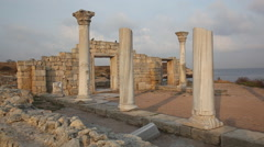 Pigeons fly up and sit down on ruins of ancient temple in Chersonese,  Crimea Stock Footage