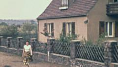 East Germany 1960: girl going out Stock Footage
