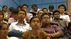 Low Angle and Pan Shot of Asian Students Sitting Inside A Lecture Hall Stock Footage