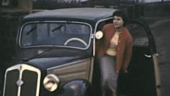 East Germany 1960: young girl entering into the car Stock Footage