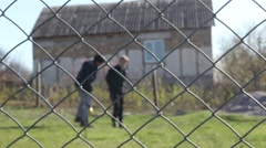 Teenager children are playing with ball behind the fence on the playground Stock Footage