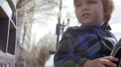 Little Boy Presses Buttons At A Pay Station For Public Transportation Stock Footage