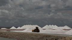 Caribbean salt lake mining work Stock Footage