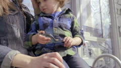 Mother And Son Wait For Public Transportation, Boy Is Sad, She Pats His Back Stock Footage