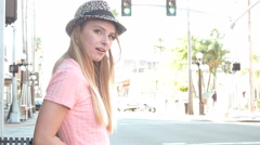 HIpster girl in urban scene busy street waiting - stock footage
