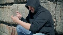 Drug addict man with syringe near hand Stock Footage