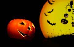 Halloween night background with scary moon and bat and pumpkin - stock photo