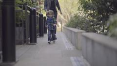 Excited Little Boy Runs Ahead Of His Mom, Exploring New Sights Stock Footage