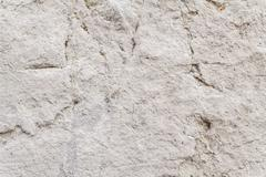 Uneven Surface Texture Of An Ancient Square Stone - stock photo
